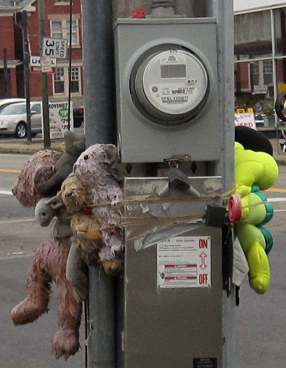 Memorial stuffed animals on North Main Street at Great Miami Boulevard on December 31, 2011